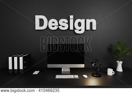 Modern Organized Tidy Office Workspace With Computer Screen And Dark Concrete Wall; Design Lettering