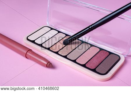 Eyeshadow Palette For Make Up On Pink Background With Copyspace. Rose Color Cosmetic Lip Stick With