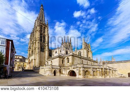 Gothic Cathedral Of Burgos By Day And With Cloudy Sky. Wide-angle Photo.