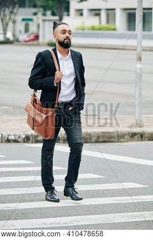 Handsome Stylish Bearded Man With Leather Bag Crossing Road