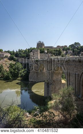 View Of Saint Martin Bridge Over The River Tagus, In The City Of Toledo, Spain