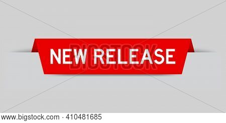 Red Color Inserted Label With Word New Release On Gray Background