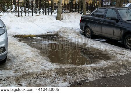 Slush.parking Lot With Mud And Puddle.asphalt Road Covered With Melting Dirty Snow And Mud.snow On T