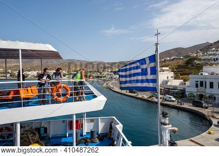 Ios, Greece - September 26, 2020: Ferry Moored At The Ios Island Waterfront. Tourists On The Deck. C