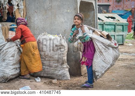 Jaipur, India. 09-05-2018. Portrait Of A Girl Collecting Recycle Garbage In The Center Of Jaipur For