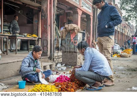 Jaipur, India. 09-05-2018. Boy Adolescent Selling Flowers On The Streets Of Jaipur In The Rajasthan