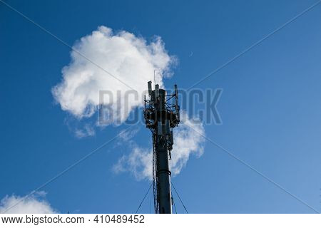 Smoke From Chemical Factory Chimney On Cloudy Sky Background. Ecology Theme.