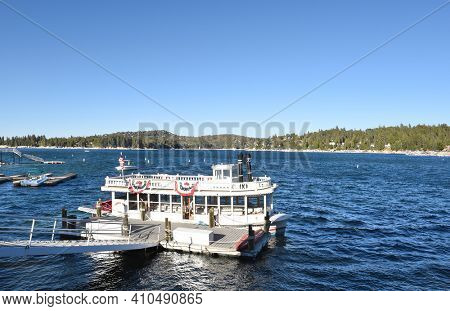 LAKE ARROWHEAD, CALIFORNIA - SEPTEMBER 25, 2010: The Arrowhead Queen tour boat. The boat lies at dock in the Arrowhead Village, a popular destination with shops, restaurants, and lodging.