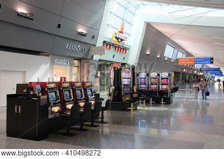 Las Vegas, Usa - April 15, 2014: Passengers Walk By Slot Machines At Las Vegas Mccarran Internationa