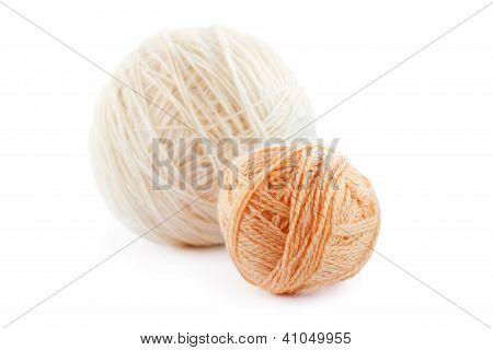 Two Beige Wool Clews