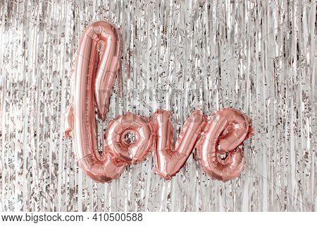 Love Pink Foil Balloon On Silver Tinsel Flat Lay. Valentines Day, Wedding Celebration. Metallic Shin