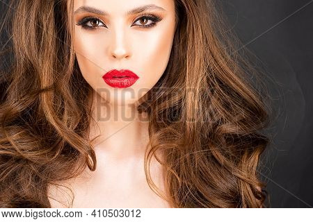 Beautiful Professional Makeup. Red Lips And Smoky Eyes Make Up. Gorgeous Glamour Fashion