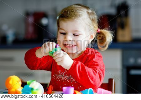 Adorable Cute Little Toddler Girl With Colorful Clay. Healthy Baby Child Playing And Creating Toys F