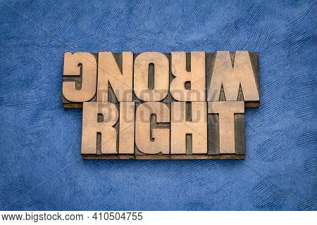 right or wrong ethical choice  dilemma - iword abstract in vintage wood letterpress printing blocks, ethics concept