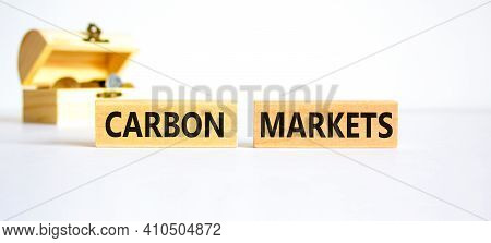 Carbon Markets Symbol. Concept Words 'carbon Markets' On Wooden Blocks On A Beautiful White Backgrou