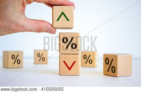 Interest Rates Symbol. Wooden Cubes, Businessman Changed The Direction Of An Arrow Symbolizing That