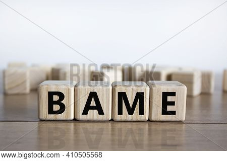 Bame Symbol. Abbreviation Bame, Black, Asian And Minority Ethnic On Wooden Cubes. Beautiful Wooden T