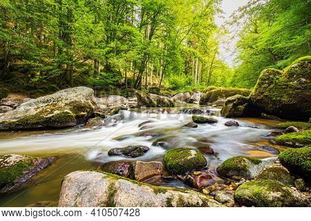Mountain River In The Wood. Scenic Landscape With Beautiful Mountain Creek With Green Water Among Lu