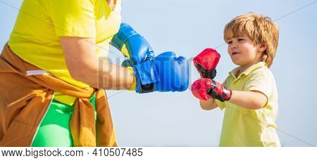 Little Boy Sportsman At Boxing Training With Coach. Little Boy Doing Boxing Exercise With Grandfathe