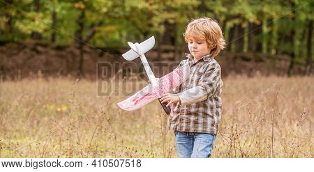 Happy Boy Play Airplane. Little Boy With Plane. Little Kid Dreams Of Being A Pilot. Child Playing Wi