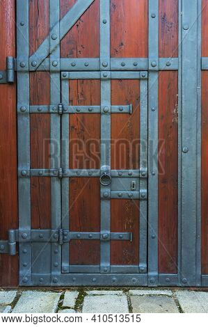 Beautiful Large Wooden Gate, Which Is Decorated With Ironwork.