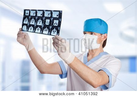 Medical Doctor Looking At Ct Computer Tomography Scan Image In Hospital