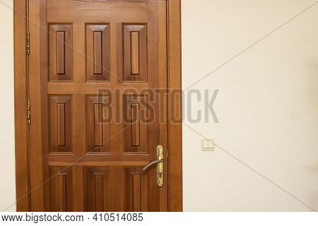 Wooden Door On White Wall Close Up, Copy Space