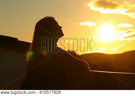 Backlight Tenant Silhouette Breathing Fresh Air In A Balcony At Sunset