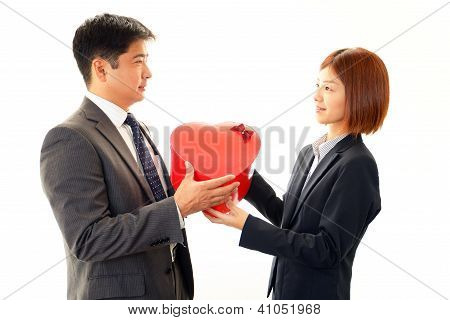 Smiling couple with a gift