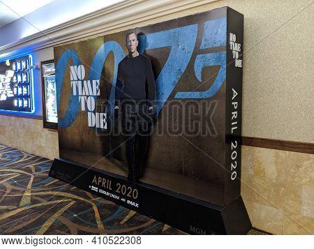 Honolulu - February 21, 2020:  007 No Time To Die James Bond Pop-up Movie Poster Inside Regal Movie