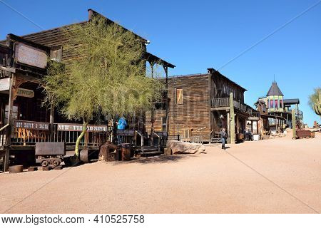 APACHE JUNCTION, ARIZONA - DECEMBER 8, 2016: Shops and looking up the street  towards Lu Lu's Bordello at the Goldfield Ghost Town, in Apache Junction, Arizona, off of Route 88.