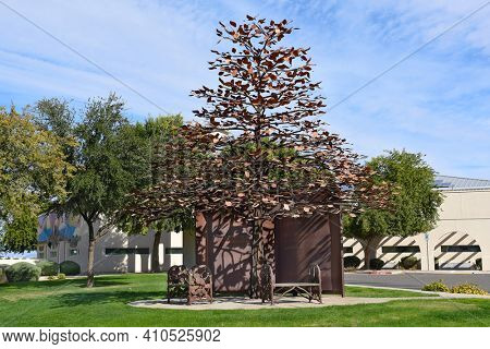SURPRISE, ARIZONA - NOVEMBER 24, 2016: The Learning Tree Sculpture by Joe Tyler. A 27-foot welded tree sits on the front lawn of the Northwest Regional Library.