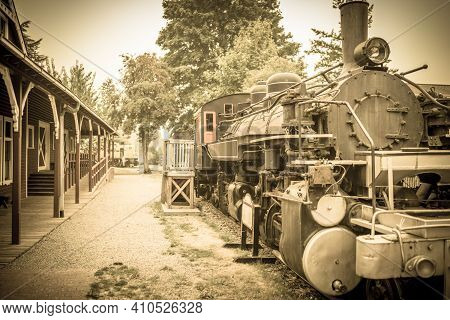 An Aged Photo Of A 20th Century Steam Engine Locomotive Train Waiting At The Station Primarily For V