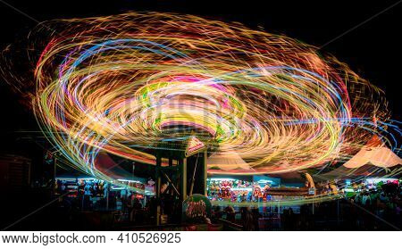 Long Exposure Of A Thrilling And Colorful Ride At The County Fair