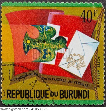 Republic Of Burundi - Circa 1974: Postage Stamp Swiss Flag And Pigeon With Letter Printed In Republi