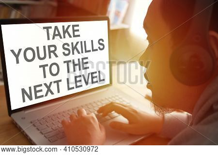 Take Your Skills To The Next Level, Person Typing On Laptop With E Learning Digital Web Program Disp
