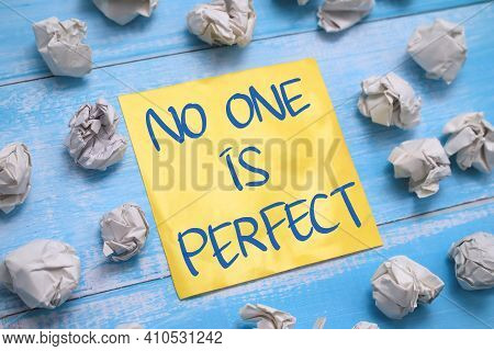 No One Is Perfect, Text Words Typography Written On Paper Against Wooden Background, Life And Busine