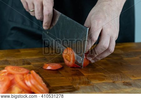 Close Up Of Chef Cook Hands Chopping Vegetables For Traditional Cuisine With Japanese Knife. Profess