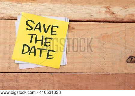 Save The Date, Text Words Typography Written On Paper Against Wooden Background, Life And Business M