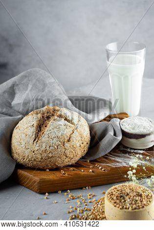 Homemade Loaf Of Freshly Baked Green Buckwheat Bread And Organic Buckwheat Milk. Wooden, Linen Napki