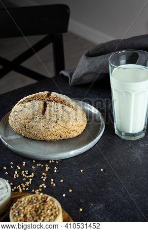 Homemade Loaf Of Freshly Baked Green Buckwheat Bread And Organic Buckwheat Milk. Ceramic,linen Napki