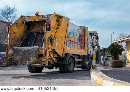 Eminonu, Istanbul, Turkey - 02.18.2021: Yellow Municipality Garbage Truck Parked In Bus Depot Of Emi