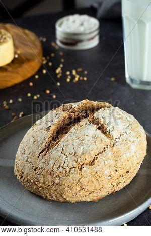 Close Up Green Buckwheat Bread And Organic Buckwheat Milk. Gray Homemade Ceramic Plate, Linen Napkin