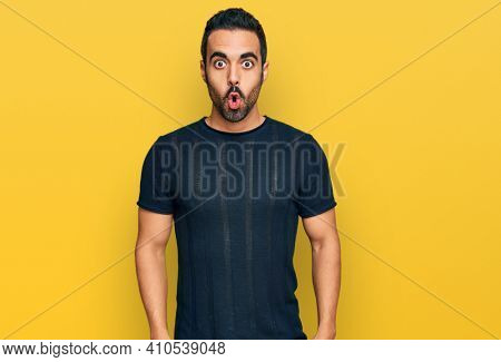 Young hispanic man wearing casual clothes scared and amazed with open mouth for surprise, disbelief face