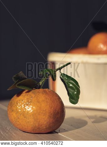 Tangerines, Clementines, Fresh Citrus Fruits On A Wood Background.