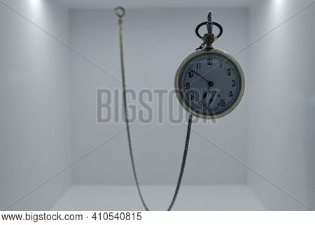A Luxury Vintage Pocket Watch Hanging In A Case. High Quality Photo