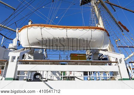 A Lifeboat Mounted On A Large Sailing Ship. Necessary Rescue Equipment On Large Sea Vessels.