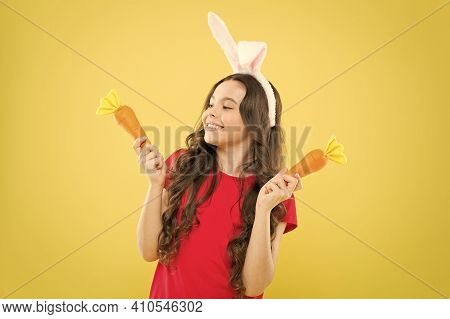 Play With Food. Benefit Of Eating Carrot. Easter Carrot. Girl Hold Carrot. Spring Tradition. Playful