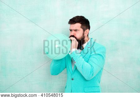 Man Inflating A Blue Balloon. Bearded Man With Balloon. Happy Birthday. Preparation To Party, Celebr