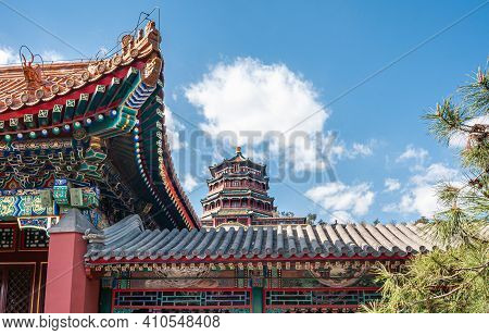 Beijing, China - April 29, 2010: Summer Palace. Vivid Colros Of Red, Golden, And More, On Roof Struc